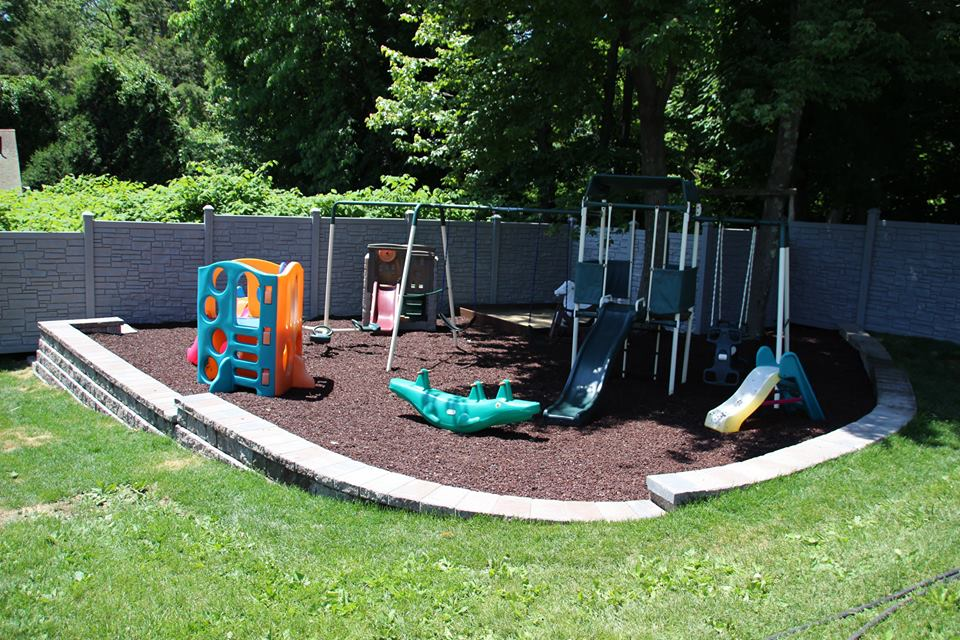 Backyard Play unilock driveway and backyard play area | backyard paradise landscaping